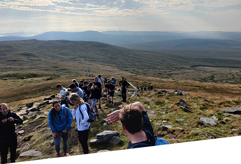 Colleagues walking up a mountain